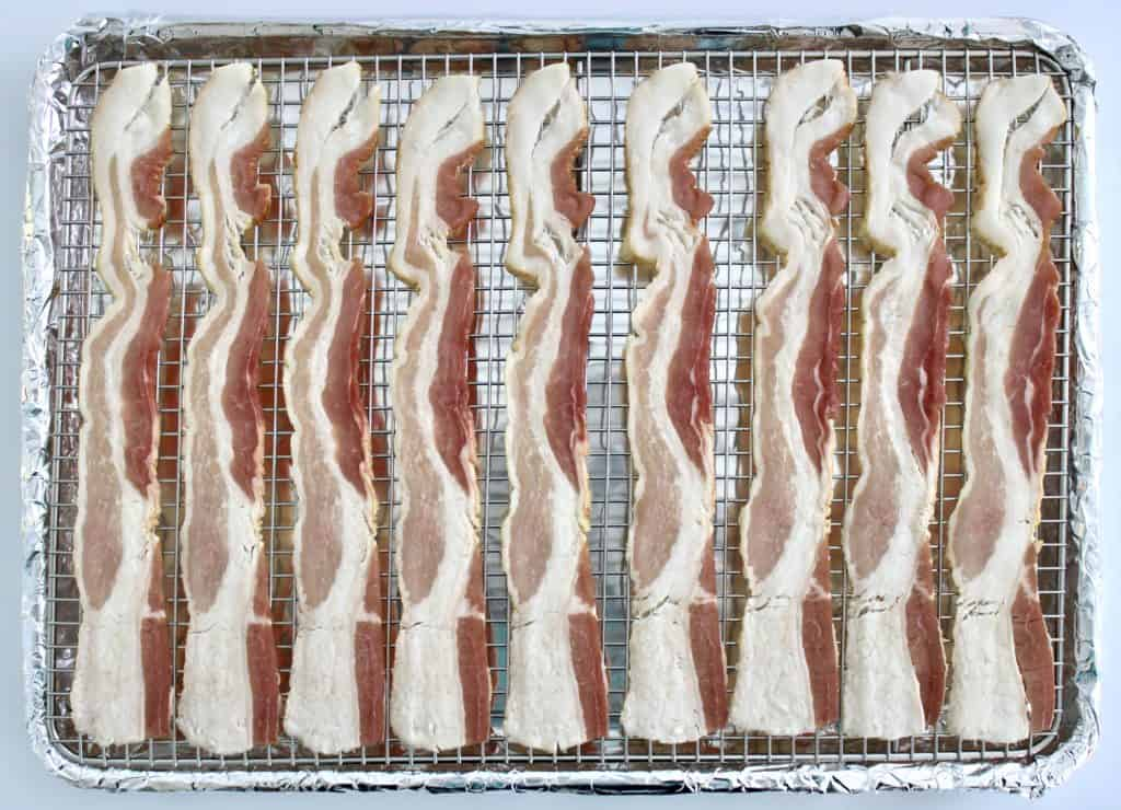 9 slices of raw bacon on baking rack