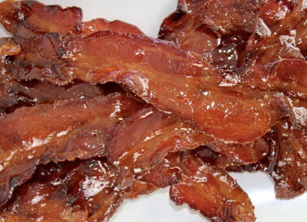 closeup on candied bacon stacked up