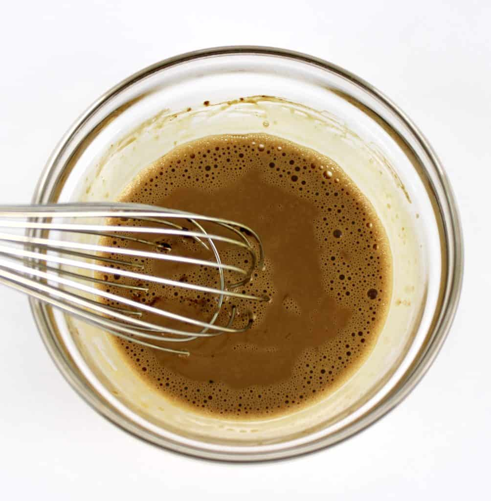 coffee mixture in glass bowl with whisk
