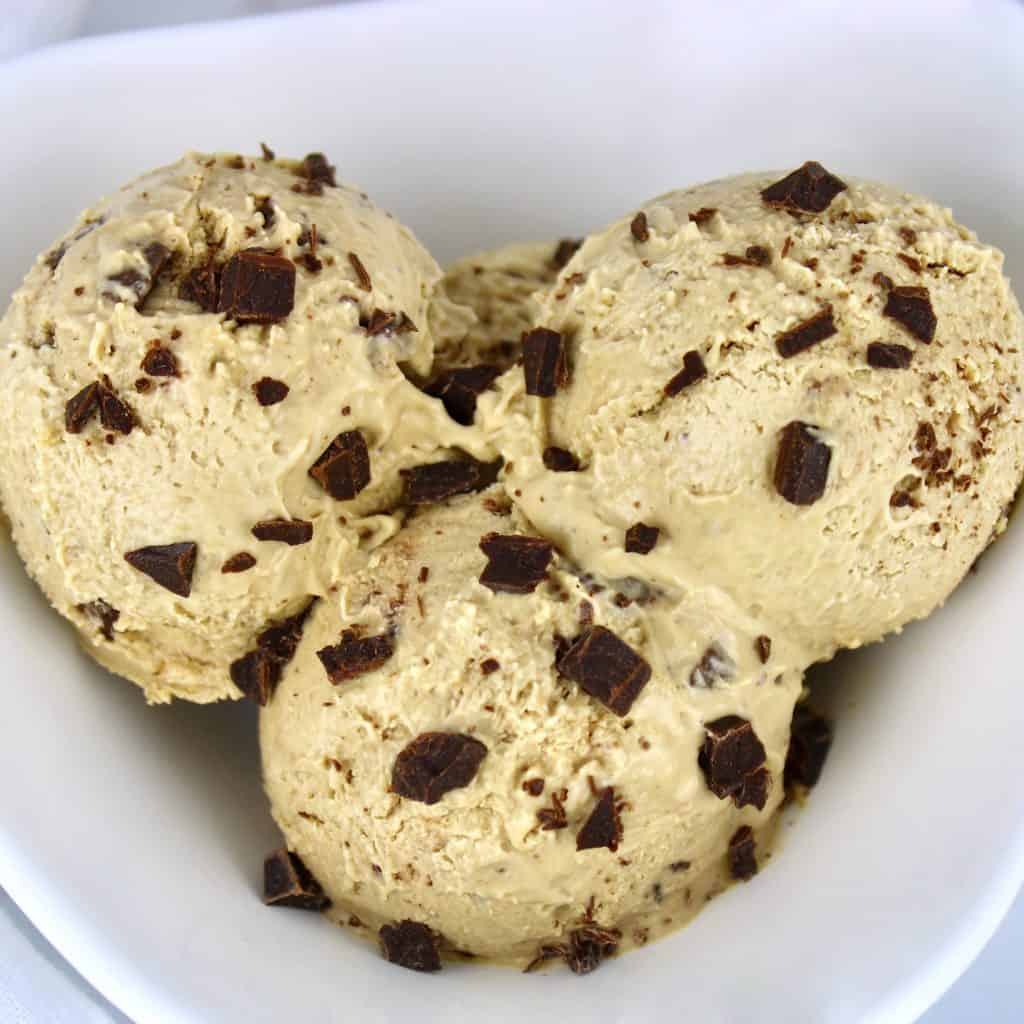 closeup of of 3 scoops of coffee chip ice cream in white bowl
