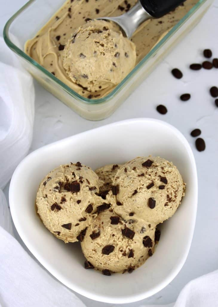 overhead view of 3 scoops of coffee chip ice cream in white bowl