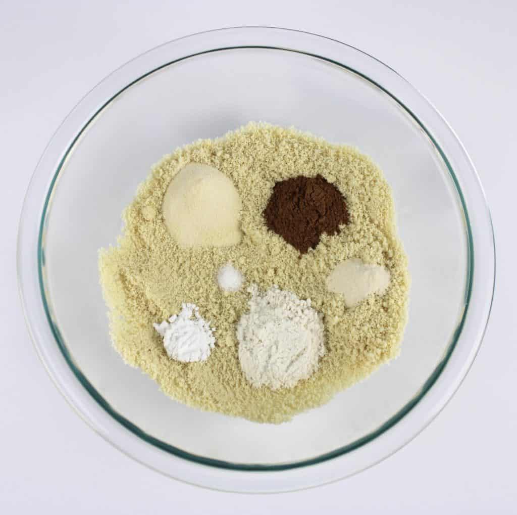 pumpkin cookies dry ingredients in glass bowl unmixed