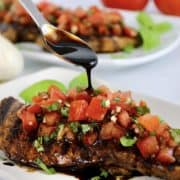 balsamic reduction spooned over chicken bruschetta