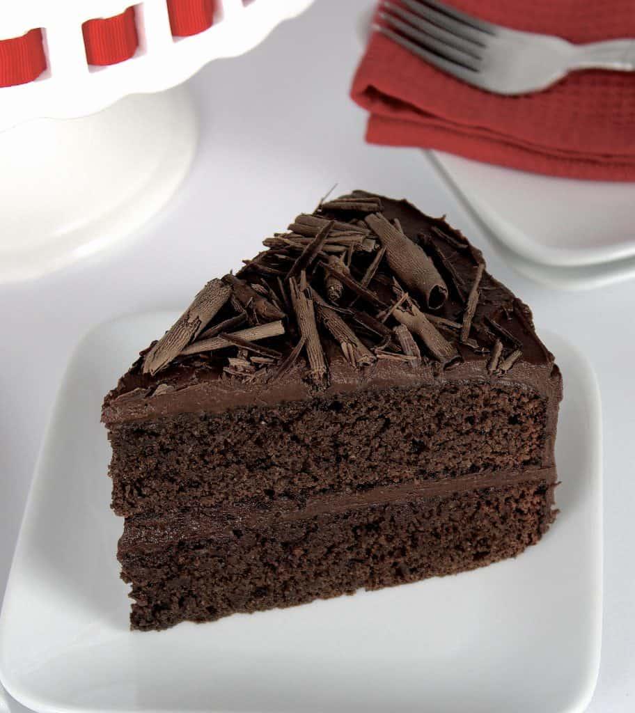 closeup of slice of Keto Chocolate Cake on white plate