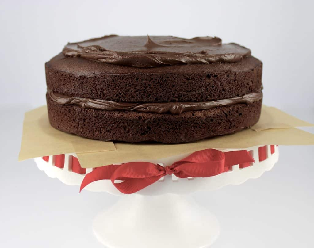 two layers of chocolate cake with frosting in between and on top