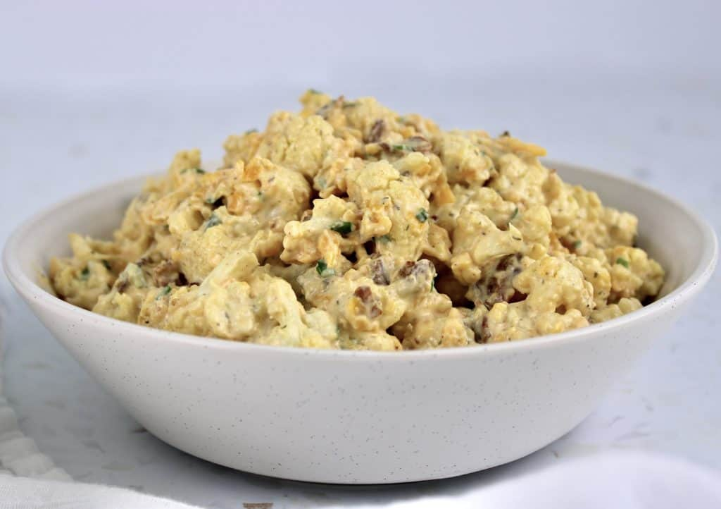 closeup of Loaded Cauliflower Salad in white bowl