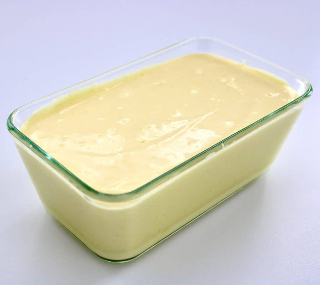 lemon ice cream batter in glass loaf pan