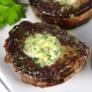 closeup of Pan-Seared Filet Mignon Pin with compound butter on top