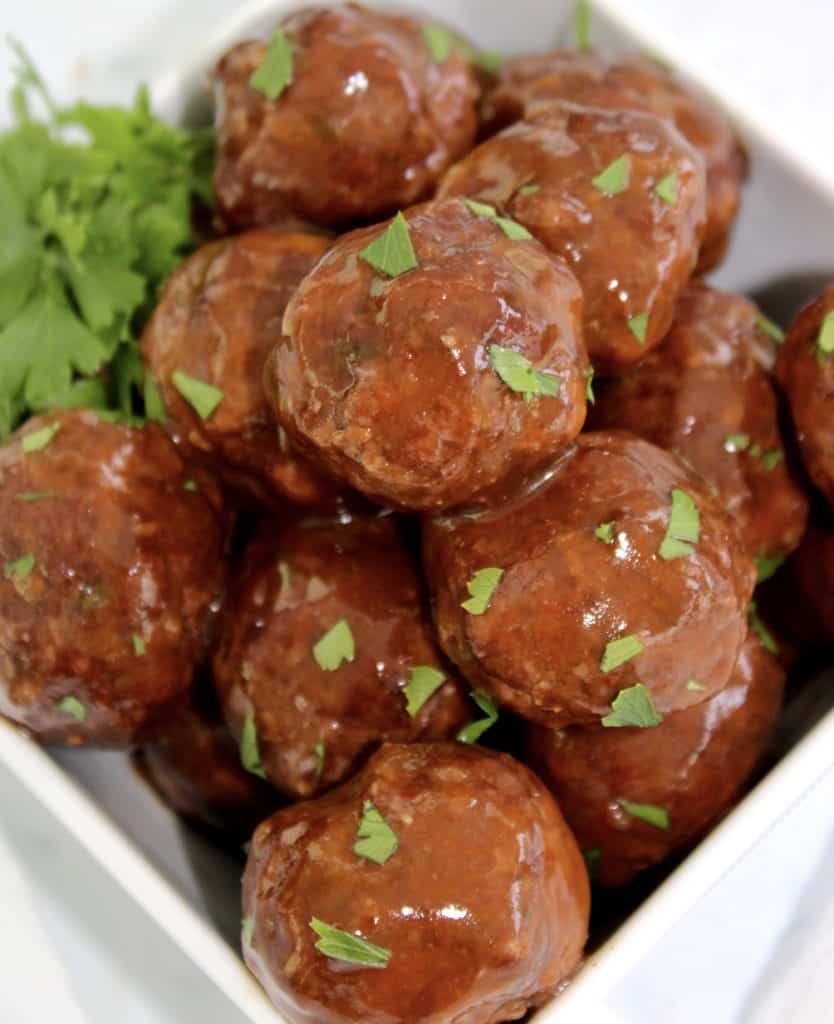 closeup of bbq meatballs in a white bowl