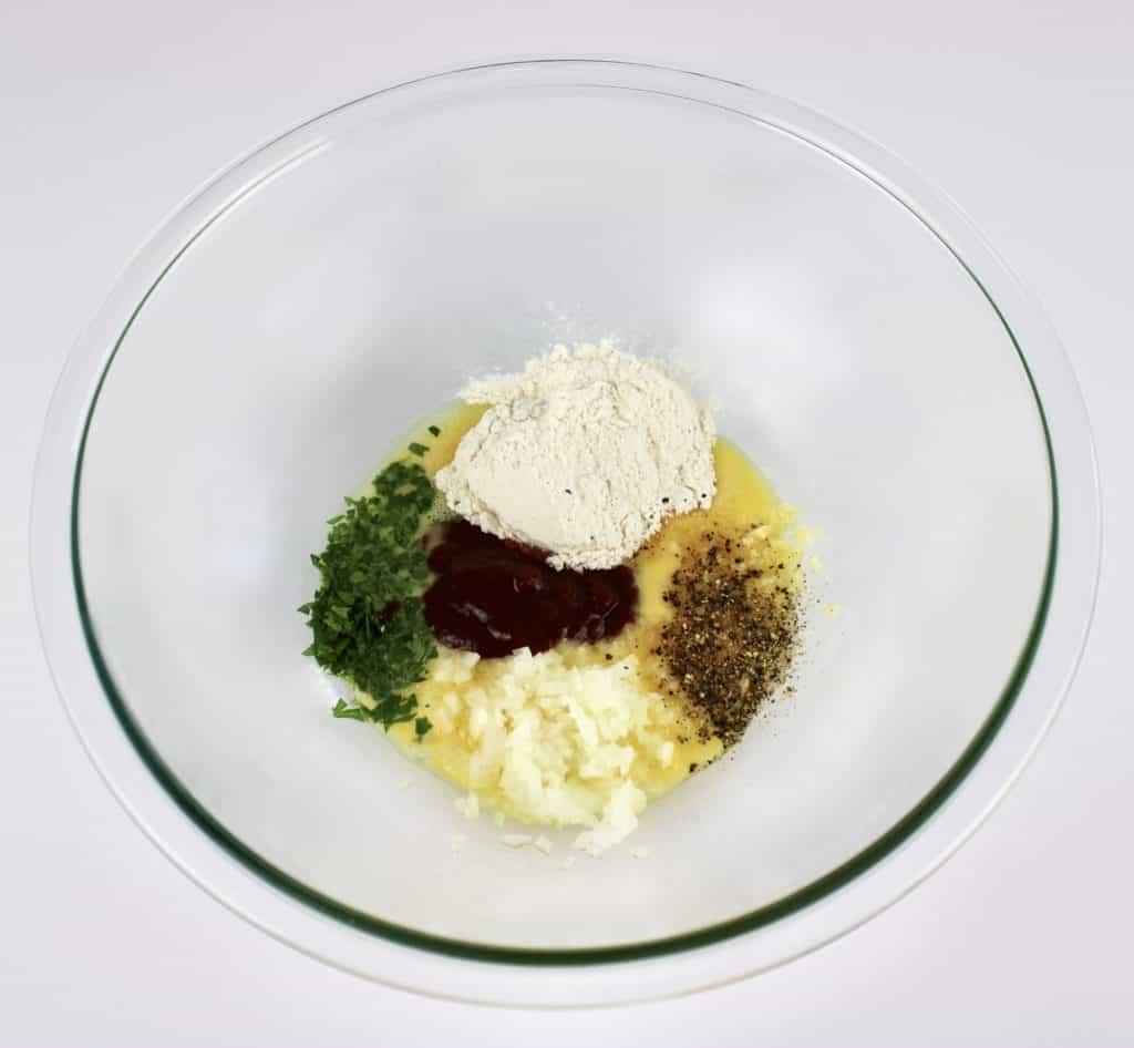 crockpot bbq meatballs wet mixture in glass bowl unmixed