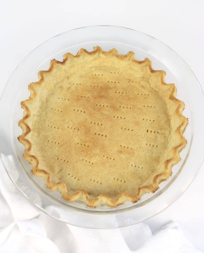 baked pie crust with crimped edges