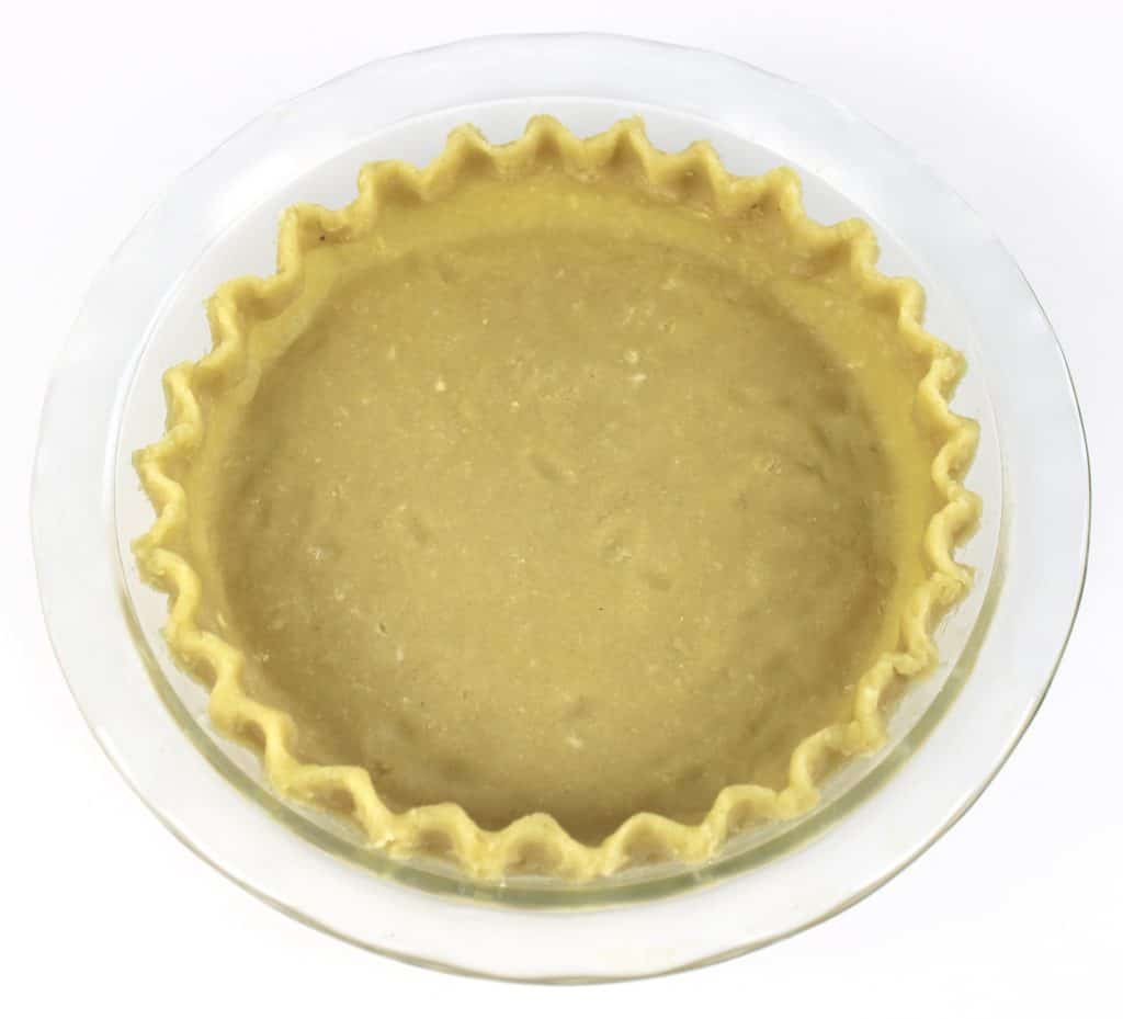 pie crust in pie dish unbaked with crimped edges