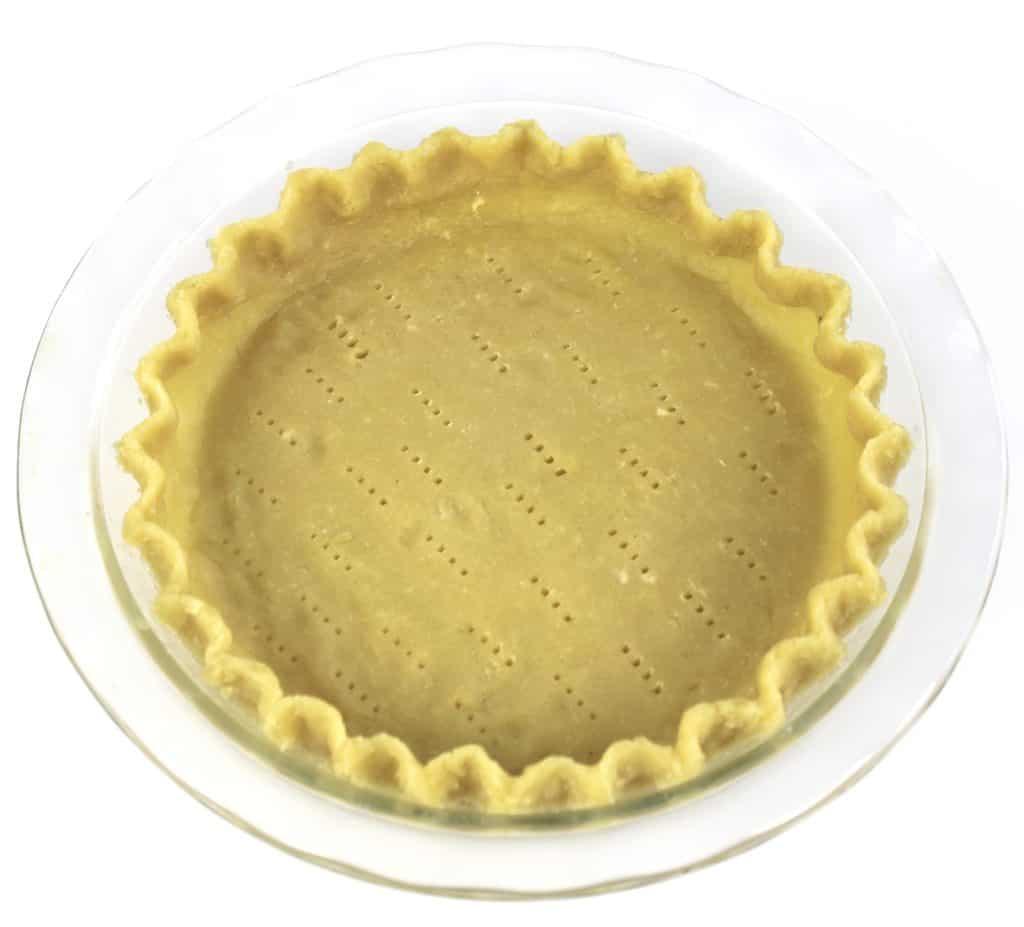unbaked pie crust in glass pie dish