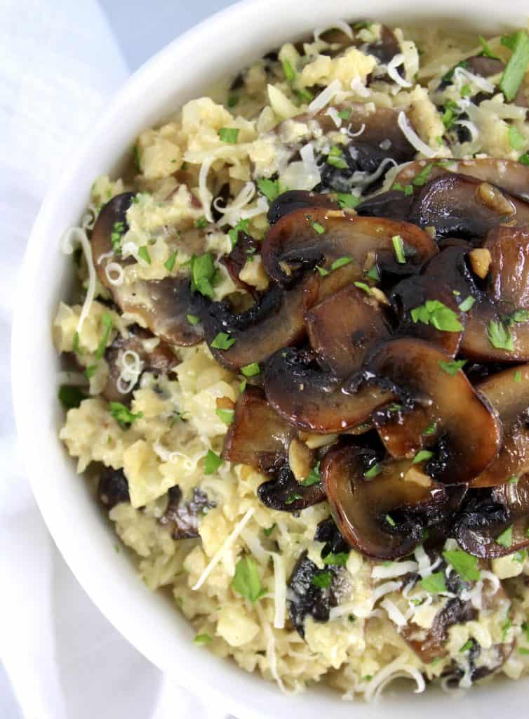 Keto Cauliflower Mushroom Risotto in white bowl with mushrooms on top