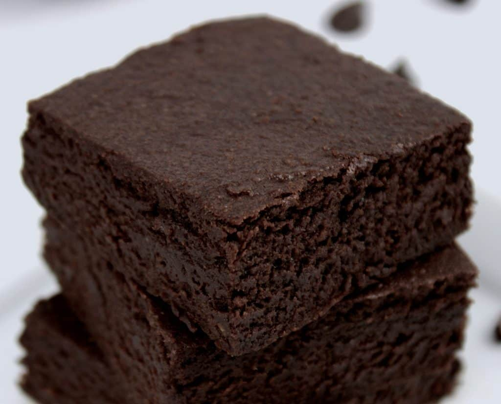 closeup of brownies stacked on plate