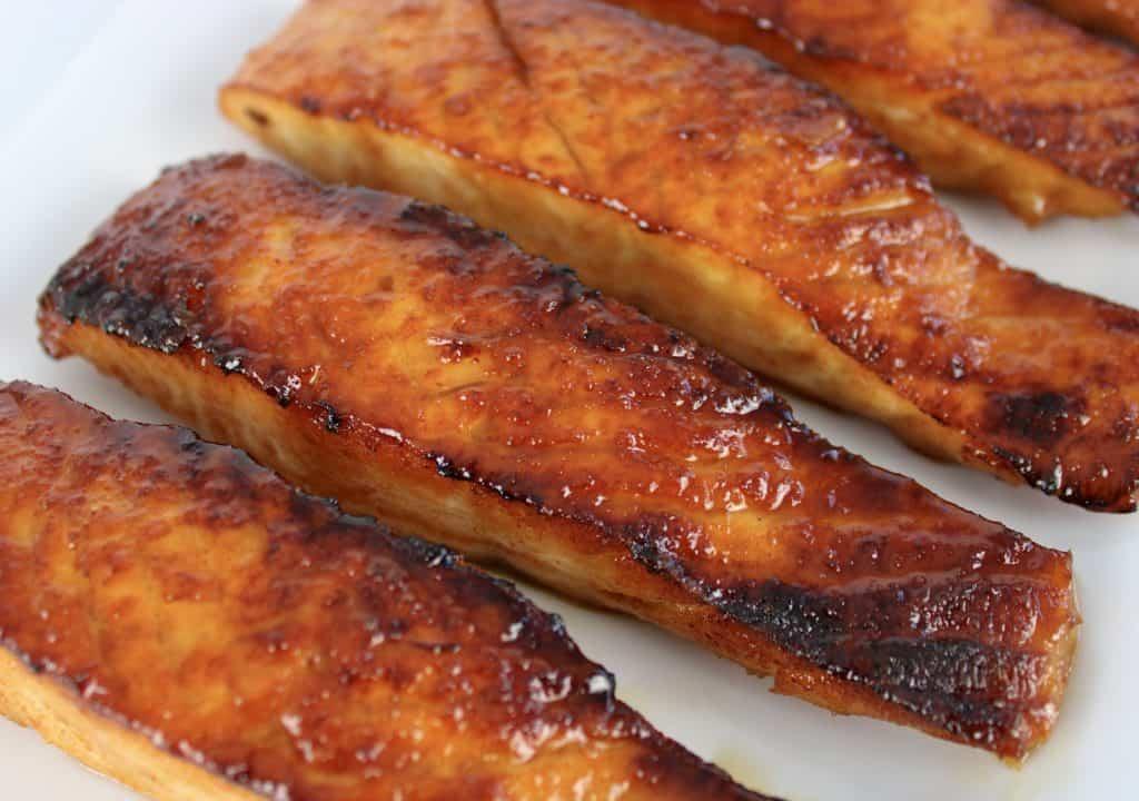 3 pieces maple glaze salmon on white plate