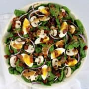 Keto Spinach Salad with Hot Bacon Dressing in white bowl