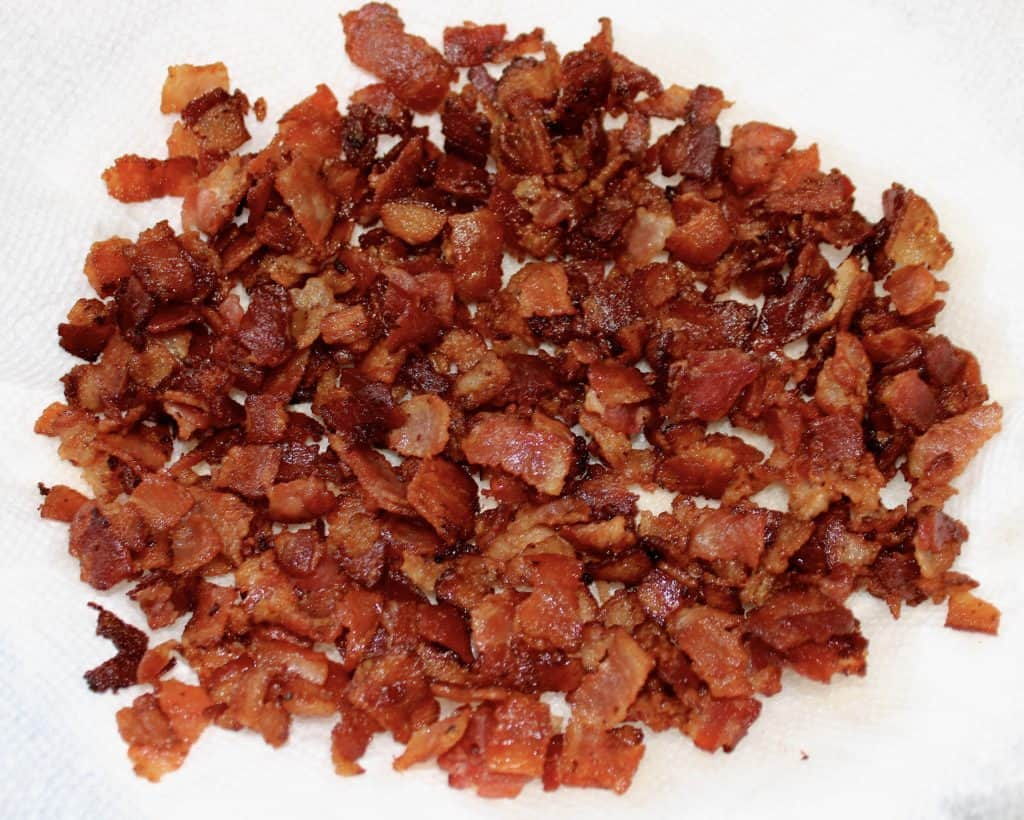 cooked bacon crumbled on paper towels