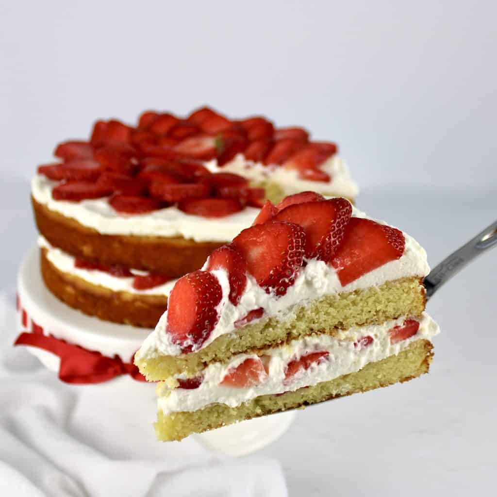 strawberry shortcake with slice being held up