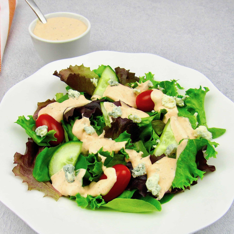 closeup of salad wtih Buffalo Ranch dressing